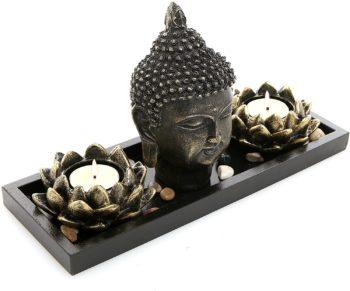 Buddha head sculpture candle holder