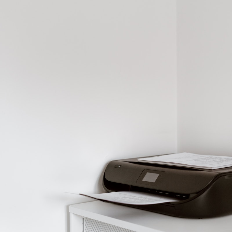 lowest cost per page printer
